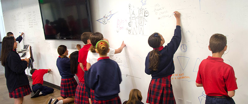 photo of children drawing on a ZURB whiteboard wall