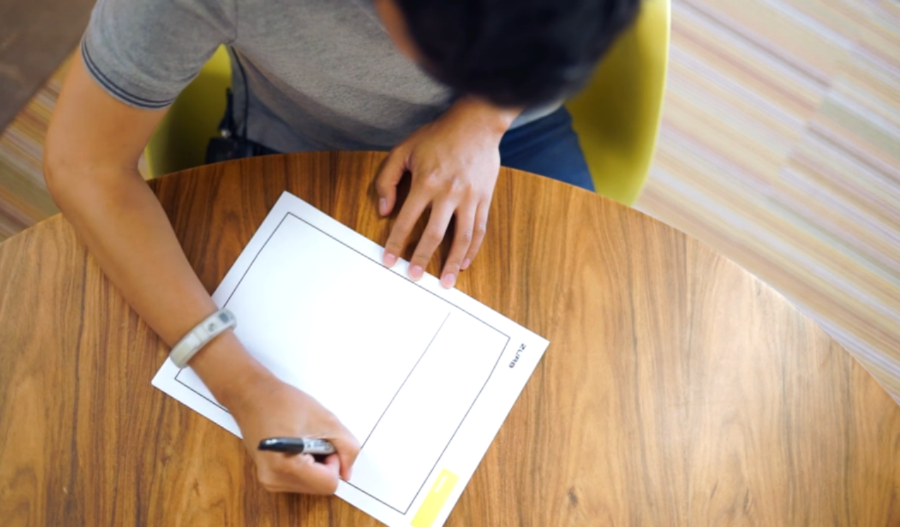photo of a designer sketching on paper